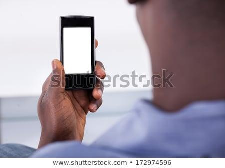 Press Button Conversion Marketing on Black Keyboard. Stock photo © tashatuvango