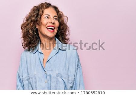 ストックフォト: 魅力的な · 成熟した女性 · ピンク · 肖像 · 深刻 · 見