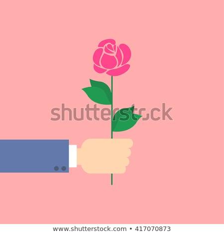Businessman modern valentine rose flower in hand Stock photo © lunamarina