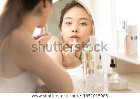 Beauty portrait of attractive tender young woman reflecting in mirror Stock photo © deandrobot