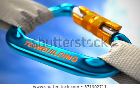 Blue Carabiner Hook with Text Teambuilding. Stock photo © tashatuvango