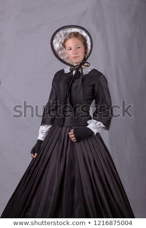 Stock photo: Young woman in black corset