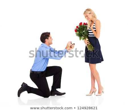 Young man down on his knees proposing Stock photo © dash