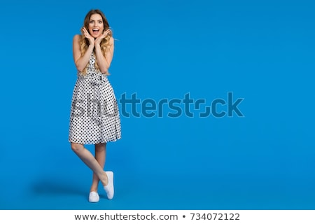 Smiling beautiful young woman in dress and sneakers Stock photo © deandrobot