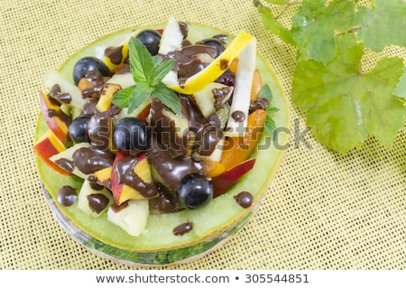Vruchtensalade chocolade kom vruchten dessert creatieve Stockfoto © M-studio
