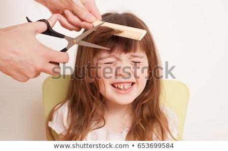 Haircut of small boy in barbershop Stock photo © bezikus