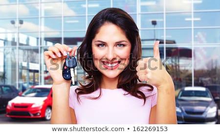 Pretty girl shows a car key Stock photo © Nobilior