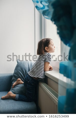 beautiful girl sitting and looking to the side Stock photo © tekso