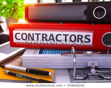 Red Office Folder with Inscription Contractors Stock photo © tashatuvango