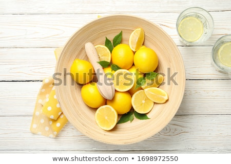 Lemonade. Drink with fresh lemons. Lemon cocktail with juice. stock photo © yelenayemchuk