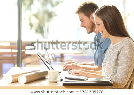 happy young casual student working on their mobile devices stock photo © feedough