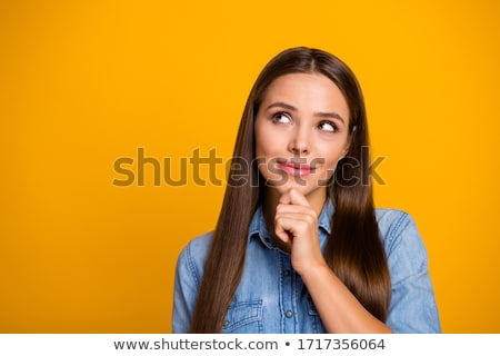 Woman thinking with hand on chin Stock photo © wavebreak_media
