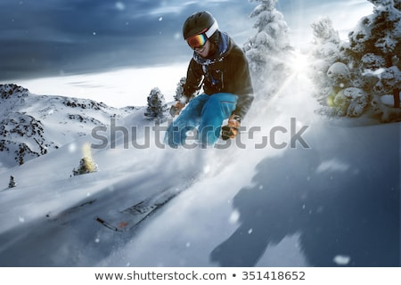 Skier carving through powder snow Stock photo © IS2