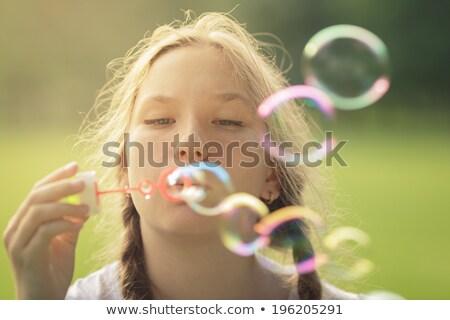 Femme domaine bulles de savon herbe nature portrait Photo stock © IS2