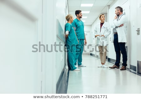 doctor and nurse standing in a hospital corridor stock photo © monkey_business