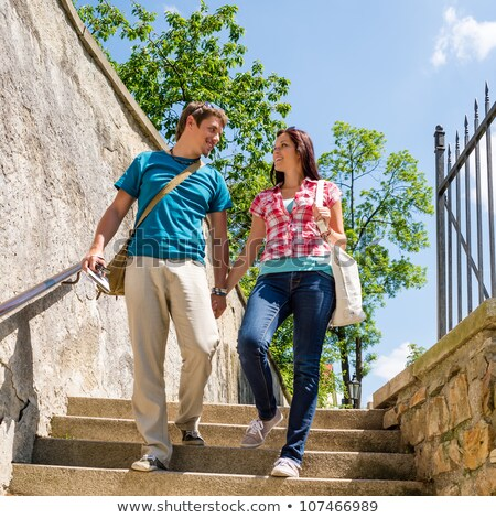 Couple climbing down the stairs Stock photo © IS2