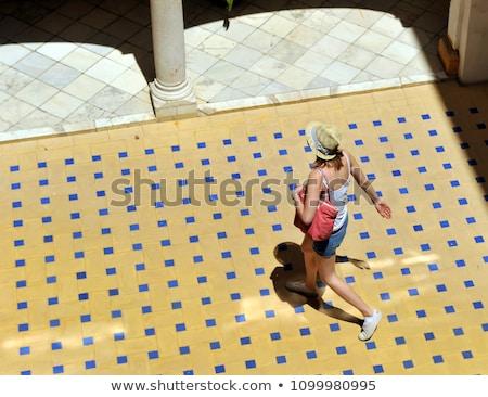 Couple walking through courtyard Stock photo © IS2
