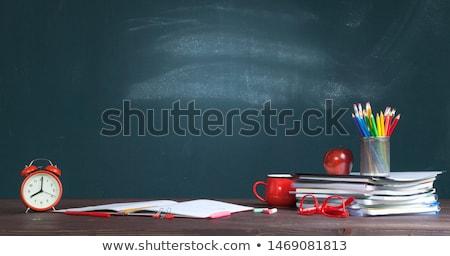 Material escolar despertador mesa de madeira prateleira de livros biblioteca Foto stock © wavebreak_media