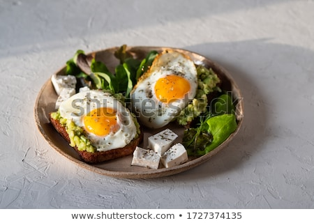 Sandwich with avocado and fried eggs Stock photo © Melnyk