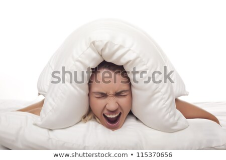 woman holding pillow over her face stock photo © andreypopov