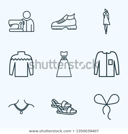 Person sewing cloth Stock photo © Kzenon