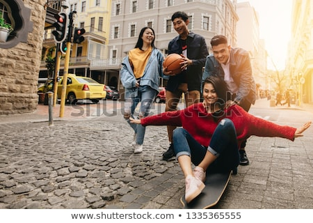 young asian female enjoying sunny day outdoors stock photo © artfotodima