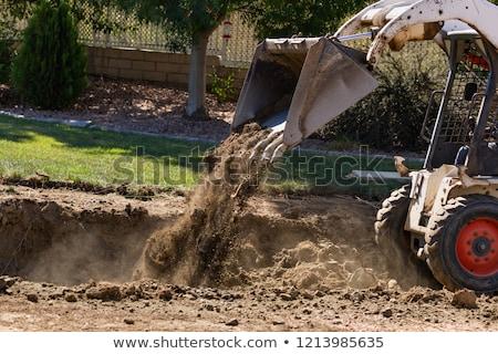Pequeno escavadeira piscina instalação grama edifício Foto stock © feverpitch