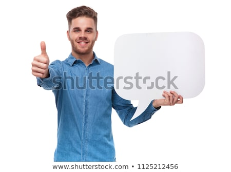 attractive casual man holds speech bubble and makes ok sign stock photo © feedough
