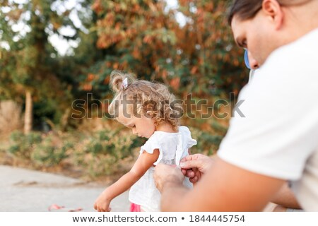 Happy young family with little baby girl spending time together Stock photo © deandrobot