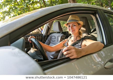 woman sitting in a rental car on holiday vacancy Stock photo © Lopolo