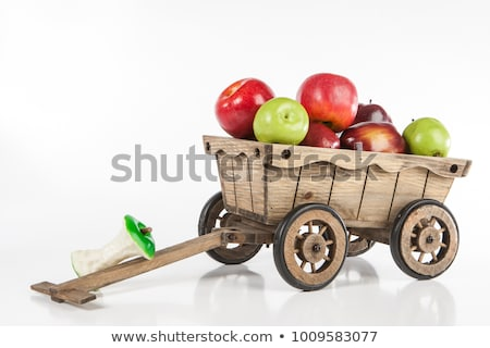 The wooden cart is filled with a harvest of ripe fruits and vegetables isolated on white background. stock photo © Lady-Luck