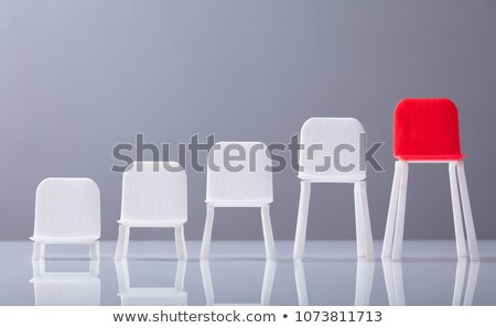 Increasing Scale Of White Chairs In A Row Stock photo © AndreyPopov