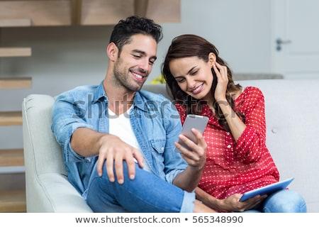 afbeelding · vrolijk · man · vrouw · smartphones · samen - stockfoto © deandrobot