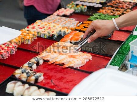 Kadın el sushi rulo somon Çin yemek çubukları Stok fotoğraf © OleksandrO