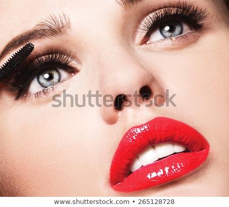 Mascara applying closeup, long lashes. Mascara brush. Eyelashes  Stock photo © serdechny