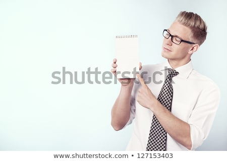 Likable businessman looking at empty notebook. Stock photo © lichtmeister