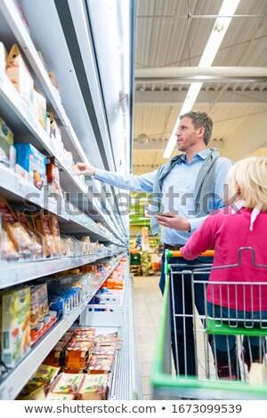 Man with his child in fresh department of supermarket Stock photo © Kzenon