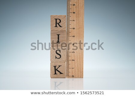 Risk Word On Blocks Near The Ruler On Reflective Desk Stock photo © AndreyPopov