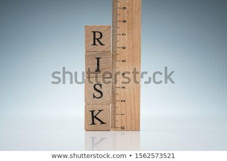 risk word on blocks near the ruler on reflective desk stock photo © andreypopov