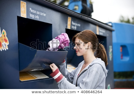 Young happy girl holding recycling waste bin. Stock photo © Lopolo