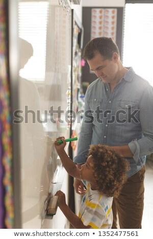 Oldalnézet kaukázusi tanár tanít valami iskolás fiú Stock fotó © wavebreak_media