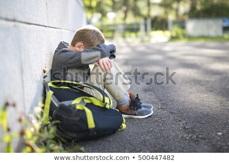 sad lonely boy in the school playground Stock photo © Lopolo