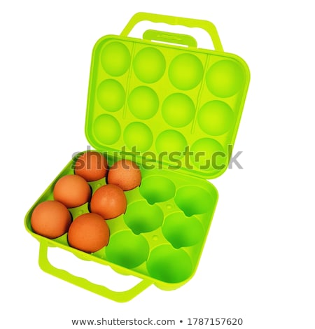 Fresh chicken eggs on plastic container and kitchen utensil on r Stock photo © marylooo