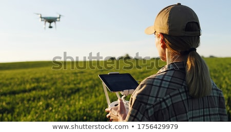 Female farmer in green wheat field in spring Stock photo © simazoran