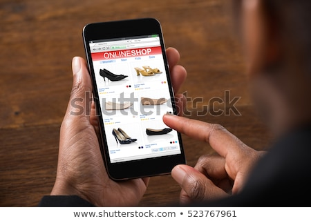 Online Ecommerce Store Holding Phone Stock photo © AndreyPopov