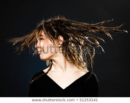 Positive young girl with dreadlocks and piercing indoors. Stock photo © deandrobot