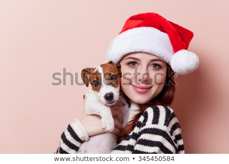 portrait of a happy young redhead woman with santas hat Stock photo © Rob_Stark
