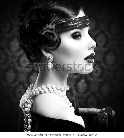 Retro woman in pearls with cigarette mouthpiece Stock photo © pekour