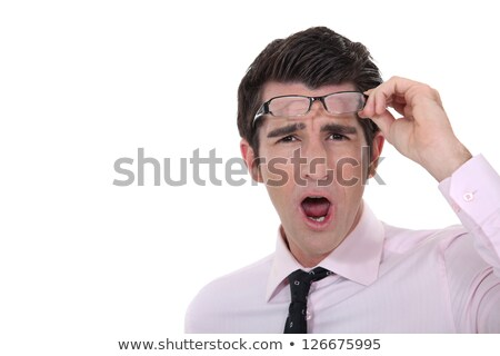 Man taking his glasses off in dismay Stock photo © photography33