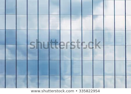 High-rise edifício de vidro reflexão praça lado negócio Foto stock © posterize
